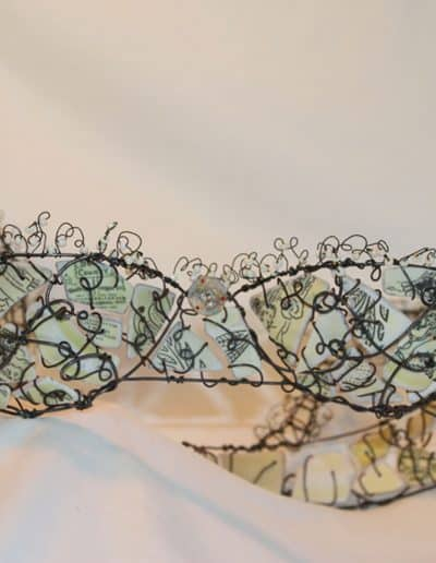 Bra made with wire, broken and tumbled dishes, with wire and glass bead lace around the edges