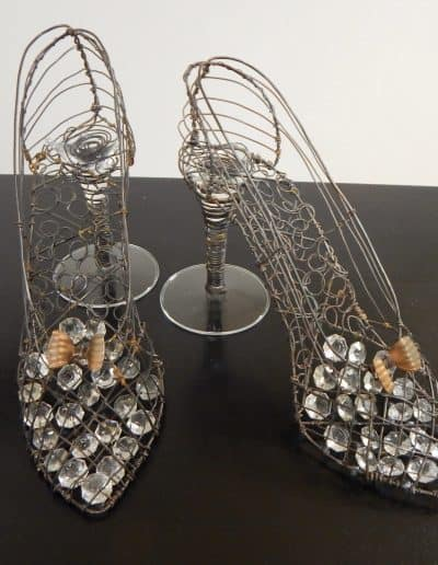 High Heels made from broken wine stems, with small crystals on the soles and copper bows on tops.