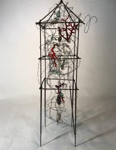 House shaped steel sculpture with wire and mixed media incorporated into the structure