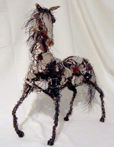 Horse sculpture made with wire and tumbled glass shards.