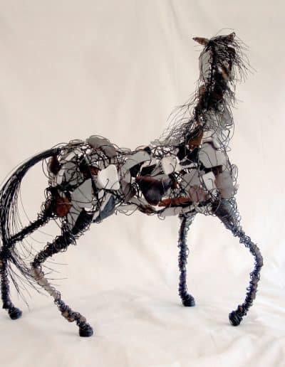 Sculpture of horse made with wire, tumble glass shards and beads for eyes.