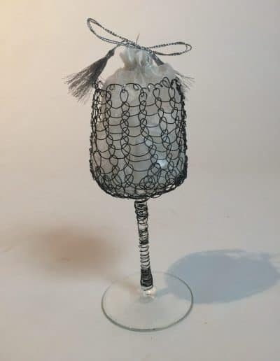 Reconstructed Mazel wine glass made with wire. The glass shards from ceremony contained in silk bag inside the glass.