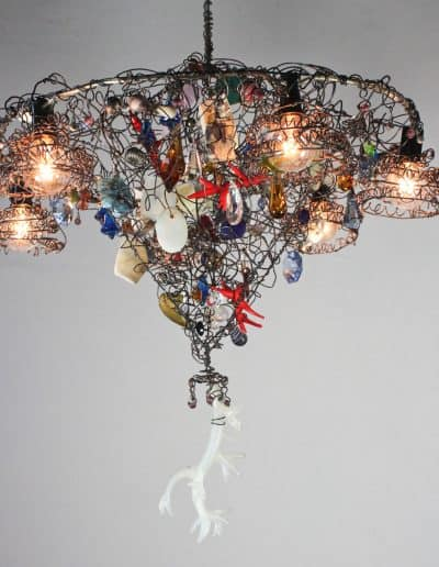 Functional Conical shaped chandelier made with wire, beads, crystals and other objects.