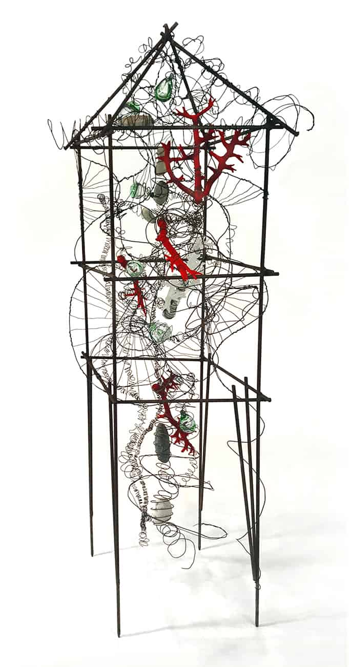 Standing house-shaped sculpture created with wire and mixed media
