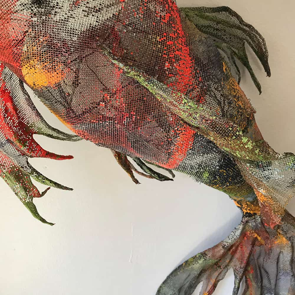 Sculpture of Koi fish created with painted and stitched aluminum screen